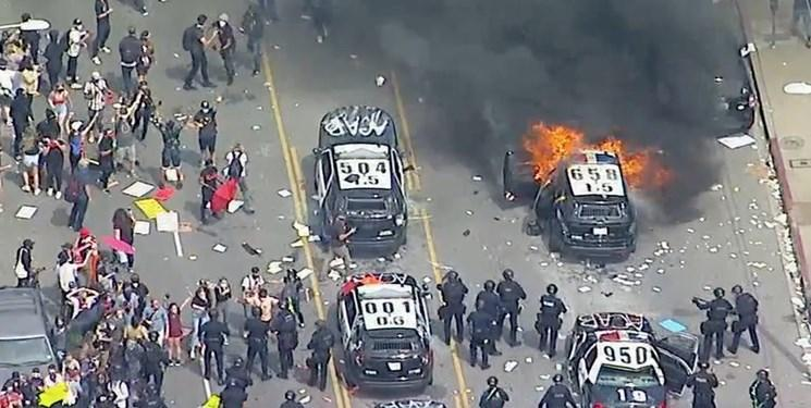 اعلام حکومت نظامی در چند شهر بزرگ آمریکا، درگیری پلیس با معترضان در سراسر این کشور